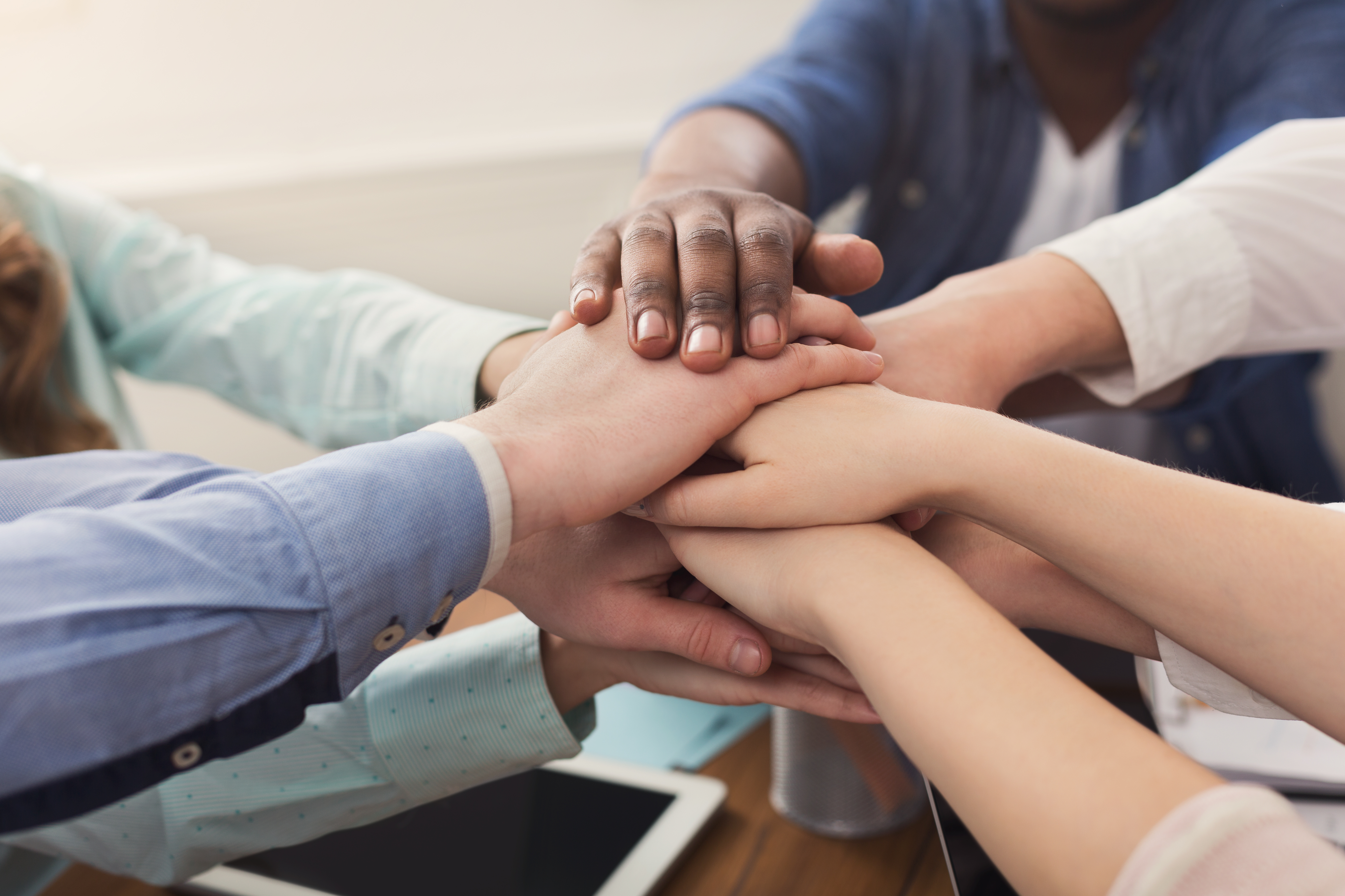 teamwork-and-teambuilding-people-connect-hands-4RUX6YS